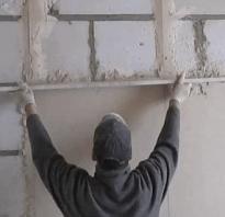 Установка маяков для выравнивания стен